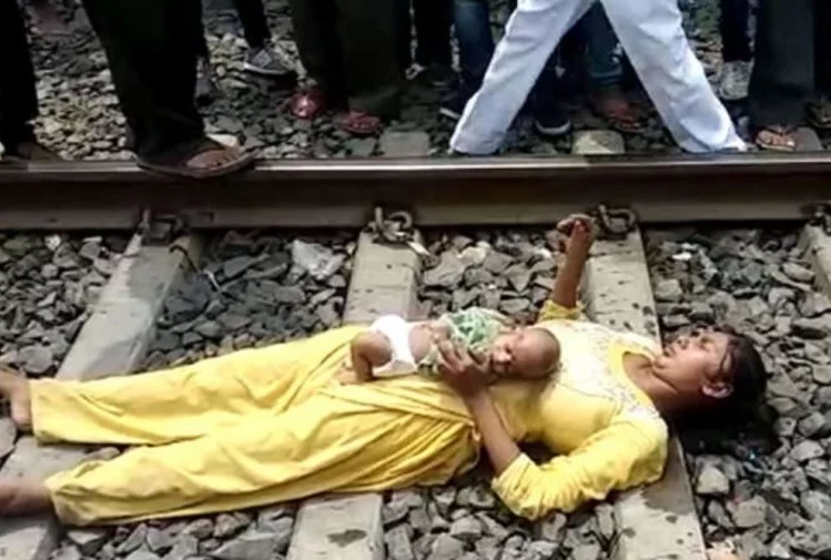 woman lying on railway track